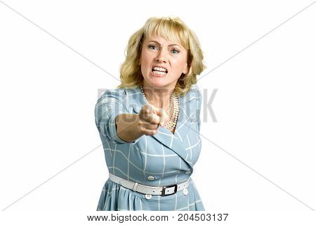 Angry woman screaming and pointing with finger. Pissed off businesswoman pointing with index finger. Irritated mature woman shouting and pointing with index finger on someone, white background.