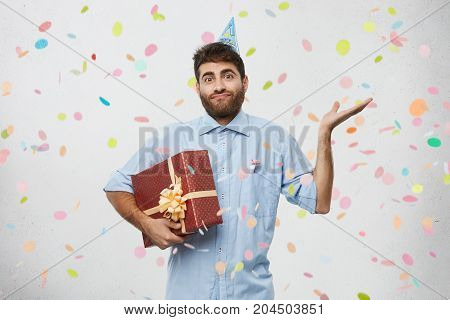 Doubtful Man Goes To Birthday Party, Shrug Shoulders As Doesn`t Know Where Celebration Takes Place,