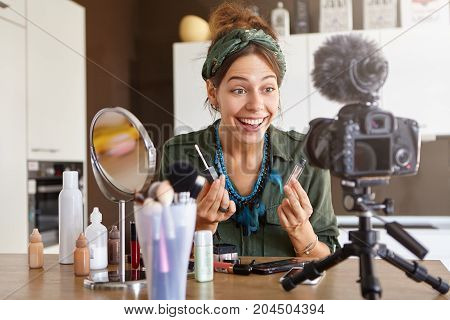 Beautiful Female Fashion Blogger Looking At Camera Fixed On Tripod, Having Excited Happy Expression,
