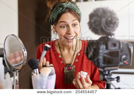 People, Lifestyle, Occupation, Business And Hobby Concept. Trendy Looking Young Female Fashion Video