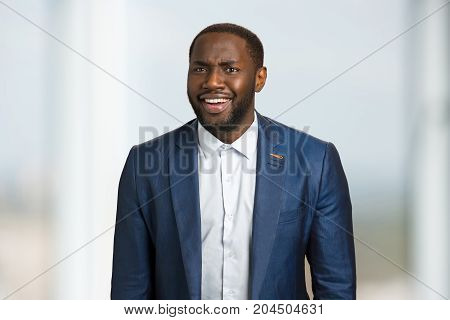 Sincere smiling afro american businessman. Black man in formal style looking happy. Cheerful manager in corporate company.