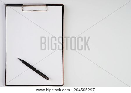 Clipboard With White Sheet And Black Pen