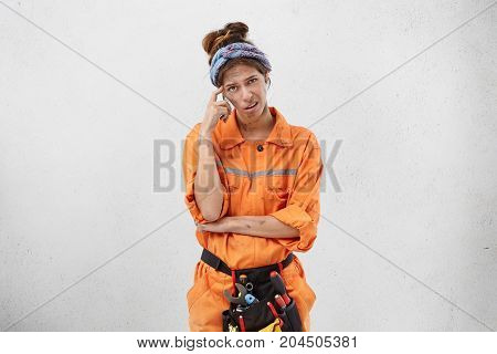 People, Job, Renovation, Repair And Maintenance Concept. Picture Of Confused Frustrated Woman Electr