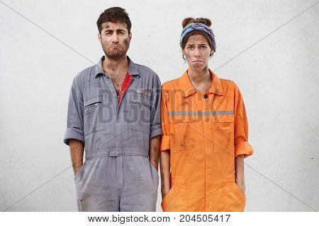 People, Facial Expressions And Problem Concept. Wretched Dirty Female And Male Maintenance Workers H