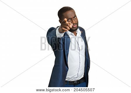 Confident buainessman pointing at camera. Handsome black man pointing on white background.