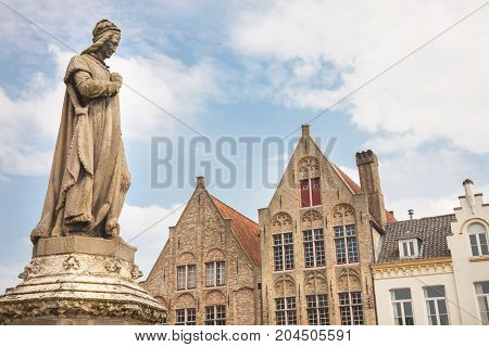 The statue erected in 1860 of the medieval poet Jacob van Maerlant in the main square of Damme a small town in the West Flanders province of Belgium