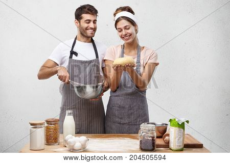 Glad Pretty Housewife Show Well Made Dough To Husband, Feel Proud Of Cooking Mastery. Affectionate H