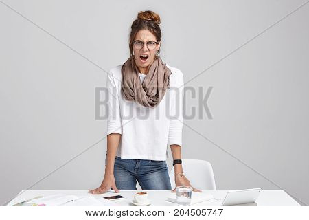 Strssed Annoyed Young Stylish Woman Businesswoman Standing At Her Workplace And Opening Mouth Widely