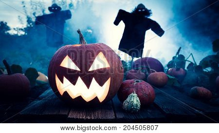 Scary Halloween Pumpkin On Dark Field With Scarecrows