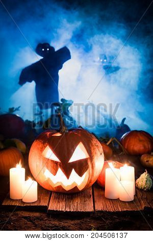 Scary Pumpkin With Scarecrows On The Field For Halloween
