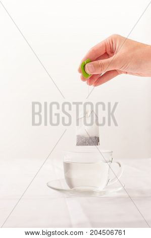 Herbal Tea Bag Over The Cup With Hot Water
