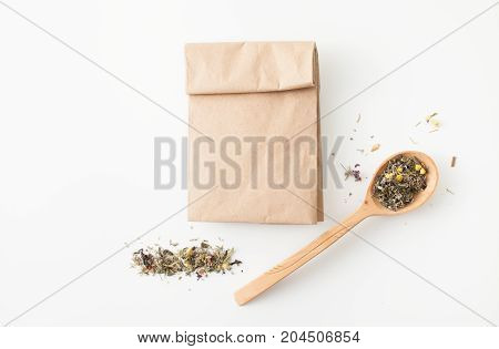 Fees Medicinal Herbs In Wooden Spoon On White