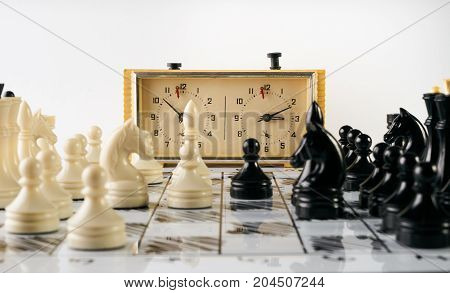 Old Stopwatch, Chess Pieces And A Chessboard