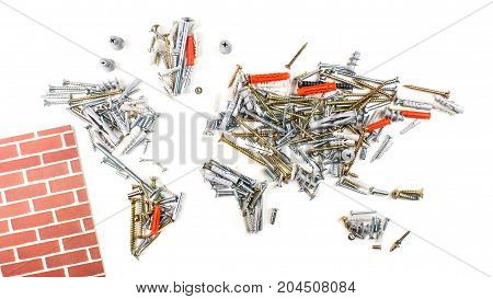 map of the world made of screws and fasteners with small part of red wall on white background worldwide construction industry concept