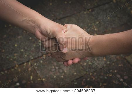 Two hands shaking each other. Teamwork and helping concept.