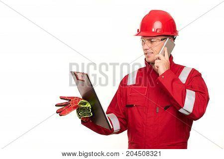 Portrait Of Architect Wear Red Safety Helmet And Workwear Uniform