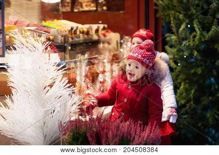 Child At Christmas Fair. Xmas Market.