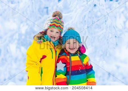 Kids Play With Snow In Winter Park