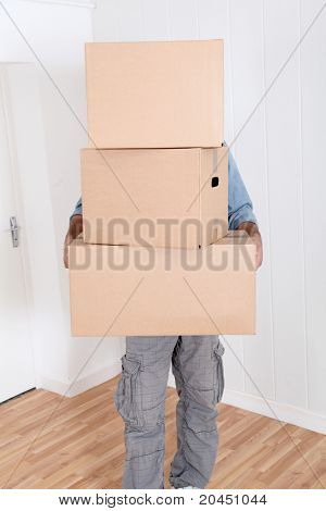 Man holding pile of boxes