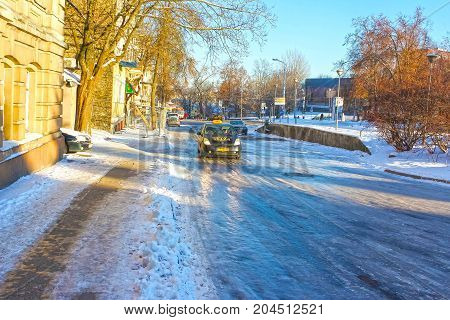 VIlnius, Lithuania - January 07, 2017: The icy road in winter at Vilnius, Lithuania