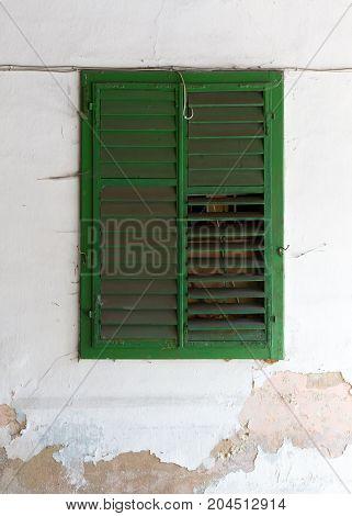Green shutter on an old wall - Austria