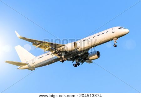 White Passenger Airplane Landing At Airport In The Blue Sky