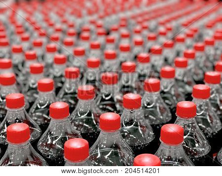 Plastic bottles with soda in the store