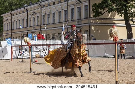 TURKU, FINLAND ON JUNE 30. View of knights during a performance, show on June 30, 2017 in Turku, Finland. Historical, medieval outdoor play. Unidentified fighter, war-horse. Editorial use.