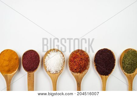 Variety Of Indian Spices And Herbs Isolated On White