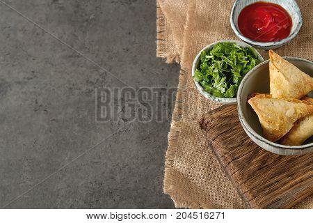 Asian Food. Vegetarian Samsa With Tomato Sauce And Herbs. Dark B