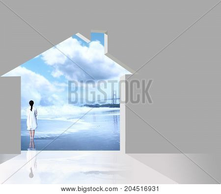 Indoor house through which you see a woman on the beach