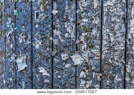 Old Urban Billboard With Torn Peeled Poster Abstract Horizontal Background. Outdoor Bulletin Board O