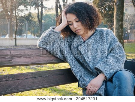 Sad Black Woman Seated Alone On A Bench