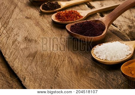 Wooden Spoons With Mixture Of Different East Spices