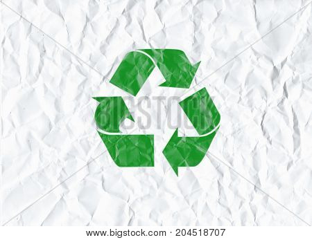White paper sheet crumpled with green recycle symbol