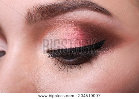 Beautiful eye makeup closeup. Female model face with fashion make-up, beauty concept isolated