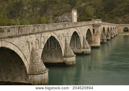 The bridge on the Drina river with crystal green water