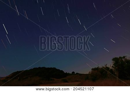 Stars slowly floating across the night sky