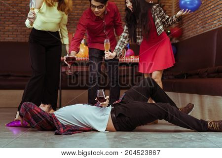 Men hang and drunk sleeping after drinking wine in x'mas party with friend group together dance
