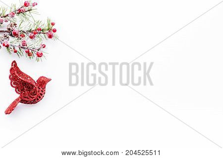 bird toys to decorate christmas tree for new year celebration with fur tree branches on white table background top veiw mockup