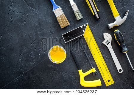 building, painting and repair tools for house constructor work place set on dark background top view space for text