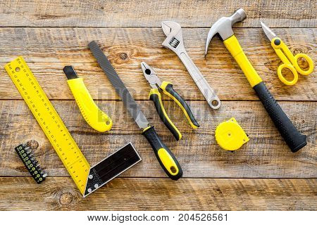 building, painting and repair tools for house constructor work place set on wooden background top view