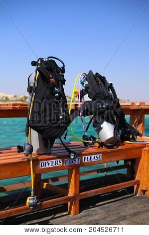 Scuba diving equipment on on the resort footbridge
