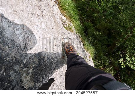 Leg And Boot Of Mountaineer