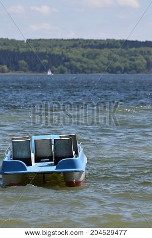 Pedalo on Lake Ammersee at the Town of Utting in Bavaria Germany