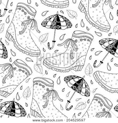 Vector autumn seamless pattern with outline rubber boots, falling leaves, umbrella and raindrops in black on the white background. Contour monochrome pattern for autumn design and coloring book.