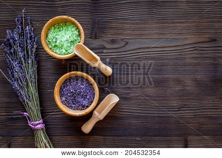 home made spa with lavender herbs cosmetic salt for bath on wooden desk background top view mock-up