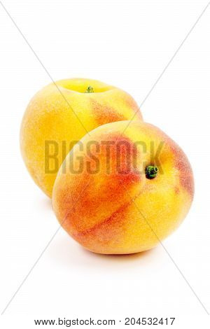 Two peach Isolated on a white background. Summer juicy fruit. Healthy food. Bright juicy colors.