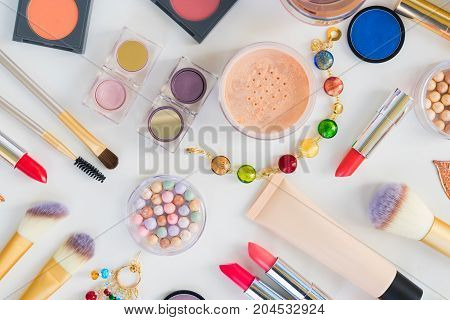 Colorful make up and brushes products top view flat lay pattern scene on white background