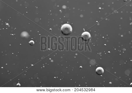Underwater air bubbles in the black-and-white. Macro